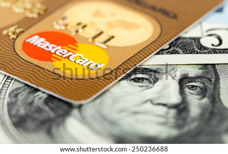 SAMARA, RUSSIA - FEBRUARY 4, 2015: Photo of Mastercard credit card with american dollars - stock photo