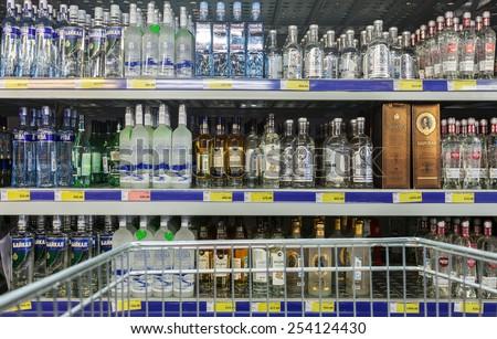 SAMARA, RUSSIA - FEBRUARY 15, 2015: Showcase alcoholic beverages at the hypermarket METRO. Metro Group is a German global diversified retailer - stock photo