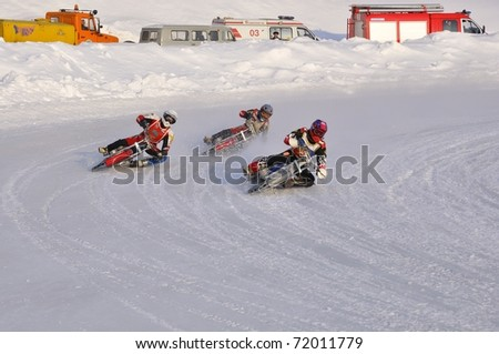 SAMARA, RUSSIA - FEBRUARY 19: Unidentified riders in action during training at Russia speedway championship on February 19, 2011 in Samara, Russia. - stock photo