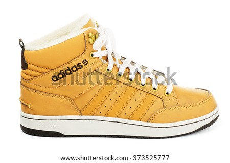 SAMARA, RUSSIA - January 4, 2016: Adidas Neo sneaker for the winter, in yellow, showing the Adidas logo and famous three stripes, illustrative editorial
