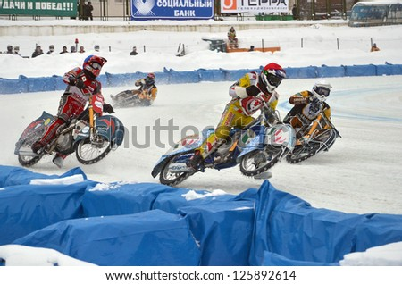 SAMARA, RUSSIA - JANUARY 19: Competing in the reversal race participants, S. Boldachev red, bl. S. Makarov, wh. V. Kosov, S. Karachentsev, ice speedway Cup of Russia January 19, 2013 in Samara, Russia - stock photo