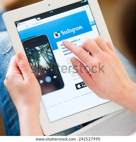 Samara, Russia - January 08, 2015: Instagram.com homepage on the ipad screen. Instagram is an online photo and video sharing and social networking service. - stock photo