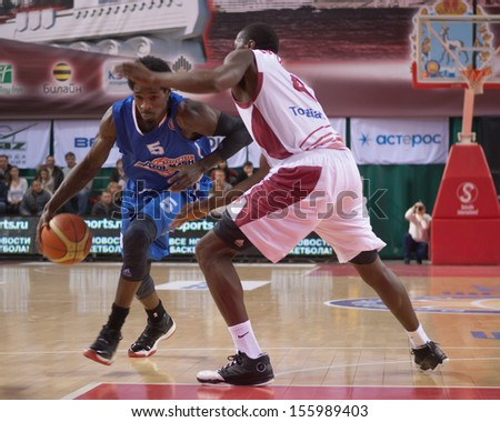SAMARA, RUSSIA - JANUARY 07: Manny Harris of BC Azovmash with ball tries to go past a BC Krasnye Krylia player on January 07, 2013 in Samara, Russia.