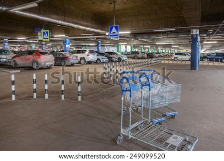SAMARA, RUSSIA - JANUARY 24, 2015: Underground car parking Mega shopping mall - stock photo