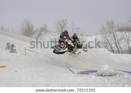 SAMARA, RUSSIA  - JANUARY 30: unidentified rider at the snow cross Russia Championship in Samara, Russia on January 30, 2011