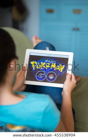 SAMARA, RUSSIA - JULY 20TH, 2016 : An Apple user plays Pokemon Go. The game announcement in Russia is delayed for some period of time - stock photo