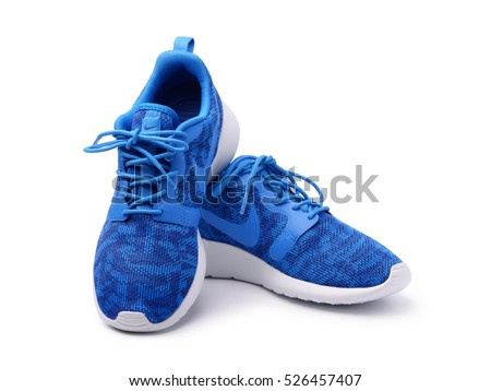 SAMARA, RUSSIA - June 8, 2015: female Nike sneakers for running, training, in gray and blue, showing the Nike logo, illustrative editorial