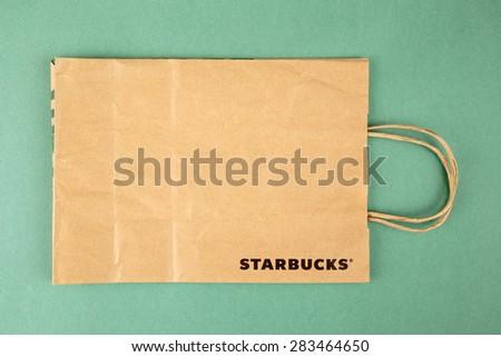 SAMARA, RUSSIA - JUNE 2, 2015: Starbucks paper bag on green background - stock photo