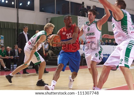 SAMARA, RUSSIA - MARCH 07: Aaron Marquez Miles of BC Krasnye Krylia with ball tries to go past a BC Zalgiris players on March 07, 2012 in Samara, Russia.