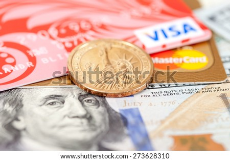 SAMARA, RUSSIA - MARCH 2, 2015: Photo of VISA and Mastercard credit card with american dollars - stock photo