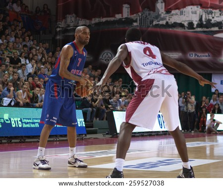 SAMARA, RUSSIA - MAY 20: Aaron Jackson of BC CSKA with ball goes against a BC Krasnye Krylia player on May 20, 2013 in Samara, Russia. - stock photo