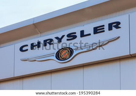 SAMARA, RUSSIA - MAY 24, 2014: Chrysler automobile dealership sign. Chrysler Group LLC is an American international automobile manufacturer headquartered in Auburn Hills, Michigan - stock photo
