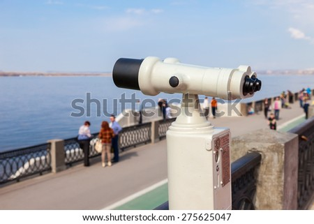 SAMARA, RUSSIA - MAY 1, 2015: Coin operated binocular on the bank of river Volga in summertime