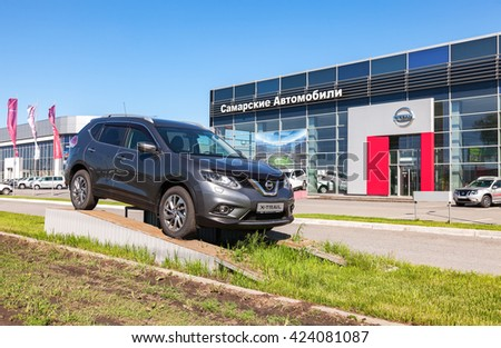 SAMARA, RUSSIA - MAY 14, 2016: Demonstration car Nissan X-Trail parked up near the office of official dealer Nissan. Nissan is a Japanese multinational automotive manufacturer
