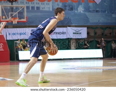 SAMARA, RUSSIA - MAY 03: Evgeny Valiev of BC Triumph, with ball, is on the attack during a BC Krasnye Krylia game on May 03, 2013 in Samara, Russia.