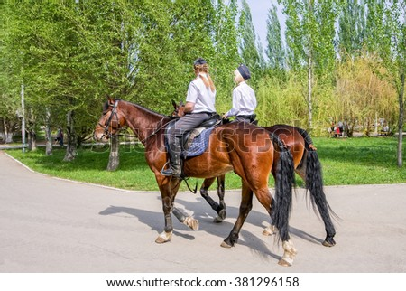 SAMARA, RUSSIA - MAY 9, 2015: Female mounted police on horse back in the city Park - stock photo