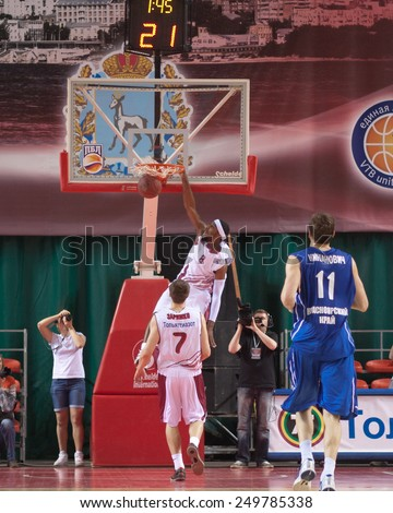 SAMARA, RUSSIA - MAY 11: Lamayne Wilson of BC Krasnye Krylia makes slam dunk in a BC Enisey game on May 11, 2013 in Samara, Russia. - stock photo