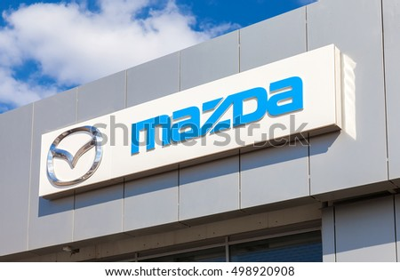 SAMARA, RUSSIA - MAY 11, 2016: Mazda logo on the facade of official dealer office. Mazda Motor Corporation is a Japanese car brand, automotive manufacturer