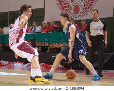 SAMARA, RUSSIA - MAY 03: Mikhail Kulagin of BC Triumph with ball tries to go past a BC Krasnye Krylia player on May 03, 2013 in Samara, Russia. - stock photo