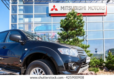 SAMARA, RUSSIA - MAY 14, 2016: Mitsubishi Pajero Sport parked up near the office of official dealer Mitsubishi. Mitsubishi Motors Corporation is a Japanese multinational automotive manufacturer