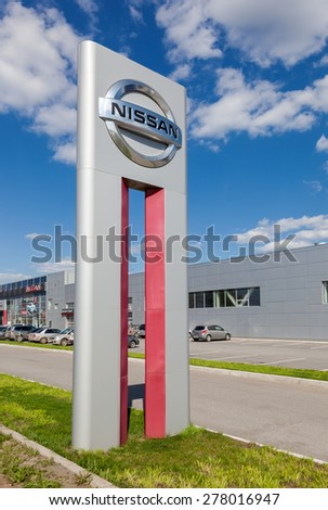 SAMARA, RUSSIA - MAY 11, 2015: Official dealership sign of Nissan. Nissan is a Japanese multinational automaker headquartered in Nishi-ku, Yokohama, Japan