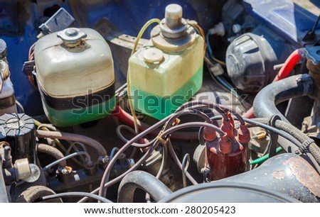 SAMARA, RUSSIA - MAY 2, 2015: Old and dirty car engine of soviet vehicle, detail view. Selective focus