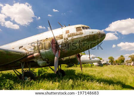 SAMARA, RUSSIA - MAY 25, 2014: Old russian turboprop aircraft at an abandoned aerodrome in summertime