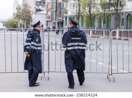 SAMARA, RUSSIA - MAY 9, 2015: Police patrol at the central street in summer day