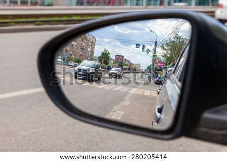 SAMARA, RUSSIA - MAY 17, 2015: reflection in the rearview mirror of a car - stock photo