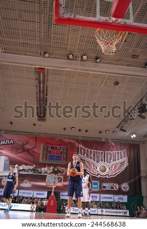 SAMARA, RUSSIA - MAY 03: Sergey Karasev of BC Triumph gets ready to throw from the free throw line in a game against BC Krasnye Krylia on May 03, 2013 in Samara, Russia. - stock photo