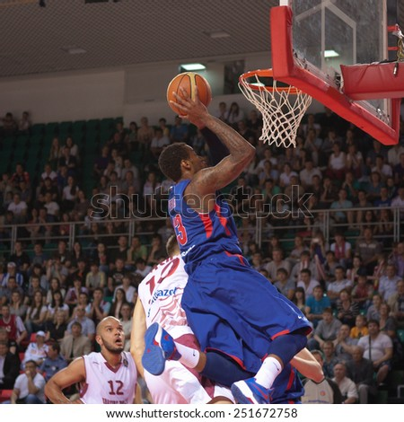 SAMARA, RUSSIA - MAY 19: Sonny Weems of BC CSKA throws the ball in a basket during a game against BC Krasnye Krylia on May 19, 2013 in Samara, Russia. - stock photo