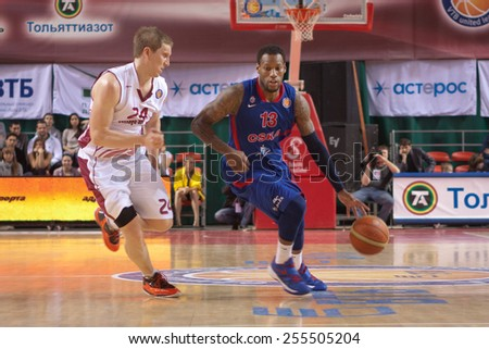 SAMARA, RUSSIA - MAY 19: Sonny Weems of BC CSKA, with ball, is on the attack during a BC Krasnye Krylia game on May 19, 2013 in Samara, Russia. - stock photo