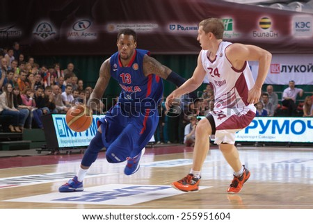SAMARA, RUSSIA - MAY 19: Sonny Weems of BC CSKA with ball tries to go past a BC Krasnye Krylia player on May 19, 2013 in Samara, Russia. - stock photo