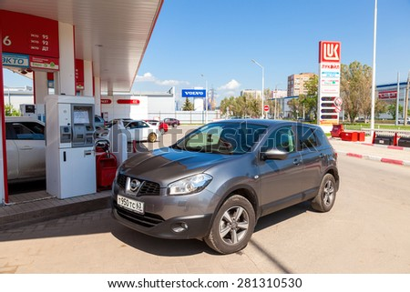 SAMARA, RUSSIA - MAY 23, 2015: The car at the petrol station Lukoil in summer day - stock photo