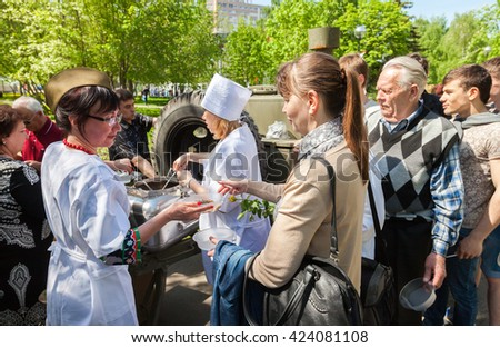 SAMARA, RUSSIA - MAY 9, 2016: Traditional distribution of cooked buckwheat porridge on the field kitchen in a city park on a holiday - stock photo