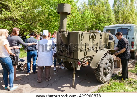 SAMARA, RUSSIA - MAY 9, 2016: Traditional distribution of cooked buckwheat porridge on the field kitchen in a city park during the Victory Day - stock photo