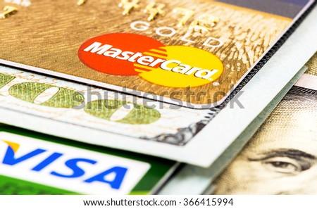 SAMARA, RUSSIA - NOVEMBER 15, 2015: American dollar bills with credit cards Visa and MasterCard - stock photo