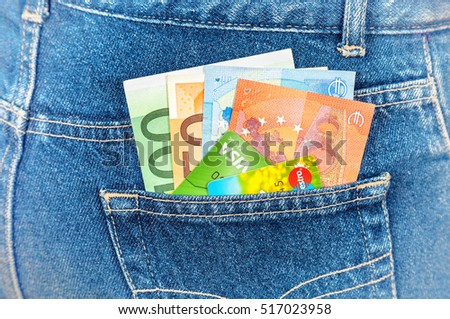 SAMARA, RUSSIA - NOVEMBER 11, 2016: Blue jeans pocket with euro notes and credit cards
