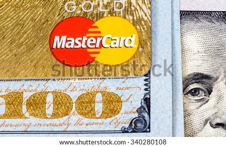 SAMARA, RUSSIA - NOVEMBER 15, 2015: Credit card MasterCard with US dollars - stock photo