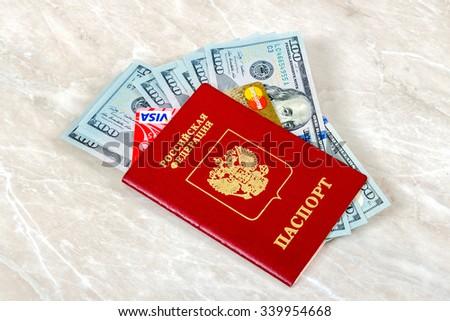 SAMARA, RUSSIA - NOVEMBER 15, 2015: Russian Passport with VISA and Mastercard Debit Card,  American dollars - stock photo