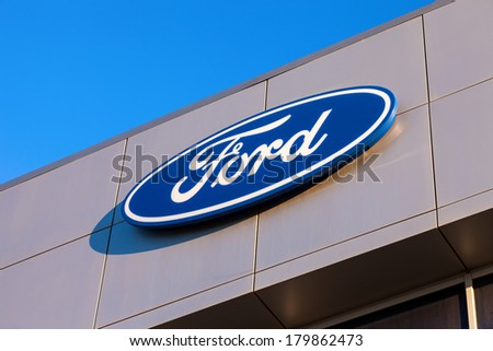 SAMARA, RUSSIA - NOVEMBER 24, 2013: The emblem Ford on the office of official dealer. Ford Motor Company is an American multinational automaker headquartered in Dearborn, Michigan, US
