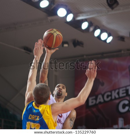 SAMARA, RUSSIA - OCTOBER 22: Chester Simmons of BC Krasnye Krylia with ball attacks a basket during a BC Astana game on October 22, 2012 in Samara, Russia.