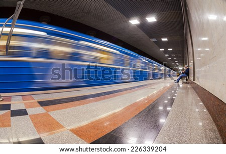 SAMARA, RUSSIA - OCTOBER 25, 2014: Passengers await the arrival of the train at subway station Rossiyskaya