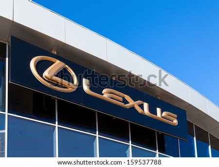 SAMARA, RUSSIA - OCTOBER 20: The emblem Lexus on blue sky background, October 20, 2013 in Samara, Russia. Lexus is the luxury vehicle division of Japanese automaker Toyota Motor Corporation  - stock photo