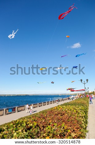 SAMARA, RUSSIA - SEPTEMBER 12, 2015: Colorful kites flying against a blue sky on the city embankment - stock photo