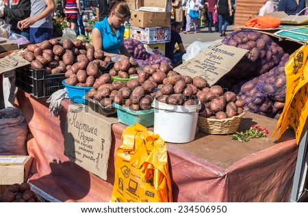 SAMARA, RUSSIA - SEPTEMBER 7, 2014: Fresh vegetables ready for sale at the traditional farmers market