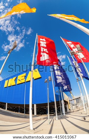 SAMARA, RUSSIA - SEPTEMBER 9, 2015: IKEA flags against sky at the IKEA Samara Store. IKEA is the world's largest furniture retailer