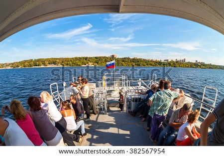 SAMARA, RUSSIA - SEPTEMBER 15, 2015: Tourists at the excursion boat traveling by the Volga river in a sunny summer day - stock photo