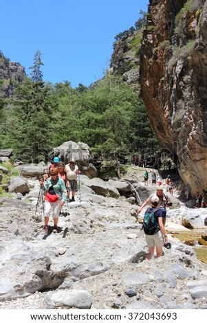 SAMARIA, GREECE - MAY 21, 2014: Tourists hike in Samaria Gorge in Crete, Greece. The national park is a UNESCO Biosphere Reserve since 1981.