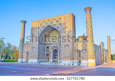 SAMARKAND, UZBEKISTAN - MAY 1, 2015: The morning sun shines the ancient walls of Ulugh Beg Madrasah on the Registan square, on May 1 in Samarkand.